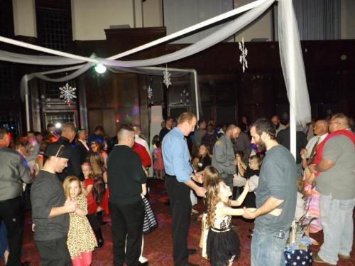 The dance floor is full at the Daddy - Daughter Dance