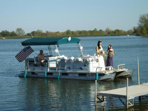 Bride Beth (Kamentz) Sasak arrives at her wedding by boat